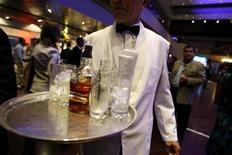 <p>A waiter offers whisky in a file photo. REUTERS/Jorge Silva</p>
