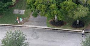 <p>The fire hydrant (L) and tree (2nd R) which were hit in an accident involving golfer Tiger Woods is seen next to Woods' house in the Isleworth community in Windermere, Florida December 1, 2009. REUTERS/Rick Fowler</p>