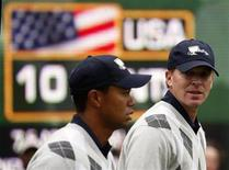 <p>U.S. team member Steve Stricker (R) talks to partner Tiger Woods during their fourball match at the Presidents Cup golf tournament at Harding Park golf course in San Francisco, California in this October 10, 2009 file photo. REUTERS/Shaun Best</p>