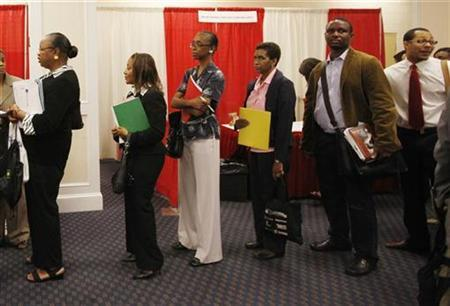 Attendees line up for an interview with a prospective employer at a job fair in Washington in this August 6, 2009 file photo. REUTERS/Jason Reed