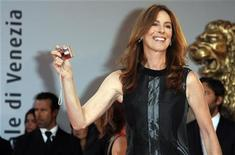"""<p>U.S. director Kathryn Bigelow takes a picture during a red carpet event at the Venice Film Festival September 4, 2008. """"The Hurt Locker"""" by Bigelow is shown in competition at the festival. REUTERS/Denis Balibouse (ITALY)</p>"""
