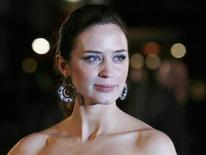 "<p>British actress Emily Blunt poses for photographers as she arrives for the World Premiere of ""Young Victoria"" at Leicester Square in London March 3, 2009. REUTERS/Luke MacGregor</p>"