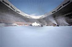 <p>Workers shovel artificial snow in front of an artificial mountain inside China's iconic national stadium, also known as the Bird's Nest, in Beijing December 16, 2009. REUTERS/David Gray</p>