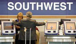 <p>A passenger waits at the Southwest Airlines ticket counter at Midway Airport in Chicago, Illinois July 24, 2008. REUTERS/Jeff Haynes</p>