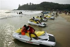 <p>Water scooters are seen parked on Baga beach in the western Indian state of Goa March 16, 2008. REUTERS/Punit Paranjpe</p>