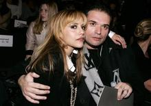 <p>Actress Brittany Murphy (L) and her husband Simon Monjack arrive for the Max Azria 2008/2009 fall collection show during New York Fashion Week in this file image from February 4, 2008. REUTERS/Carlo Allegri/Files</p>