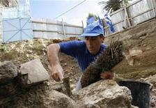 <p>A worker of Israel Antiquities Authority (IAA) clears dirt at an excavation site of an ancient house in the northern Israeli city of Nazareth December 21, 2009, near the Church of the Annunciation. Remains of a house from the time of Jesus have been found in Nazareth -- the first discovery of its kind in the place where he grew up, Israel's Antiquities Authority said on Monday. REUTERS/Gil Cohen Magen</p>