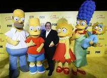 <p>Matt Groening (C), creator of The Simpsons, poses with characters from the show (L-R) Homer, Bart, Lisa, Marge and Maggie at the 20th anniversary party for the television series at Barker hangar in Santa Monica, California October 18, 2009. REUTERS/Mario Anzuoni</p>
