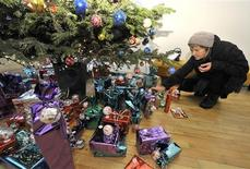 <p>A woman checks gifts under a Christmas tree in the newly opened Darilnica (the Gift Shop) in Ljubljana December 22, 2009. REUTERS/Srdjan Zivulovic</p>