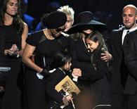 <p>Michael Jackson's sisters, Janet Jackson (2nd L) and LaToya Jackson (3rd R) comfort two of his children, Paris (2nd R) and Prince Michael II (aka Blanket), as actress Brooke Shields (L) watches, during a memorial service for music legend Michael Jackson at the Staples Center in Los Angeles, California July 7, 2009. REUTERS/Gabriel Bouys/Pool</p>