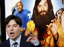 """<p>Cast member Mike Myers gestures at the premiere of """"The Love Guru"""" at the Grauman's Chinese theatre in Hollywood, California June 11, 2008. REUTERS/Mario Anzuoni</p>"""