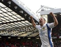 <p>O jogador do Leeds Michael Doyle comemora após ganhar do Manchester United na partida pela Copa da Inglaterra. No estádio de Old Trafford, em Manchester, Inglaterra, 3 de janeiro de 2010. REUTERS/Darren Staples</p>