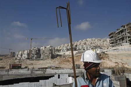 A Palestinian labourer is seen at a construction site in a settlement near Jerusalem known to Israelis as Har Homa and to Palestinians as Jabal Abu Ghneim December 29, 2009. REUTERS/Ronen Zvulun