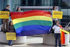 <p>Supporters of gay marriage unfurl a rainbow flag before hearing the New Jersey Supreme court decision on same-sex marriage in front of the Supreme court building in Trenton, New Jersey, October 25, 2006. REUTERS/Tim Shaffer</p>