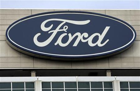 The blue Ford logo is seen on top of the Ford Motor Co. headquarters in Dearborn, Michigan December 16, 2009. REUTERS/Rebecca Cook