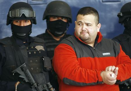Mexican Federal Police present Teodoro Garcia Simental, known as ''El Teo'' or ''Tres Letras'' a member of Tijuana cartels to the media in Mexico City January 12, 2010. REUTERS/Eliana Aponte