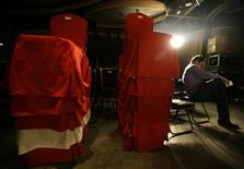 """<p>A staff of the """"Mr. Gay China"""" pageant sits next to chairs after the pageant was shut down by police in Beijing January 15, 2010. REUTERS/Jason Lee</p>"""
