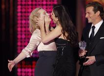 <p>Actress Meryl Streep (L) and Sandra Bullock kiss after their tie win for best actress at the 15th Critics' Choice Movie Awards at the Hollywood Palladium in Los Angeles January 15, 2010. Presenter Bradley Cooper is shown (R.) REUTERS/Mario Anzuoni</p>