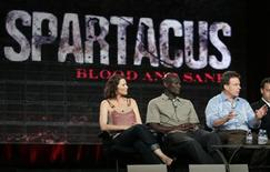 """<p>Actors Lucy Lawless (L) and Peter Mensah (C), stars of the STARZ channel series """"Spartacus: Blood and Sand"""", listen as executive producer Rod Tapert talks about the show at the Television Critics Association Cable summer press tour in Pasadena, California July 29, 2009. REUTERS/Fred Prouser</p>"""