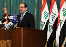 <p>Iraqi's Prime Minister Nuri Al-Maliki gestures as he speaks during a conference in Baghdad January 22, 2010. REUTERS/Iraqi Government/Handout</p>