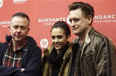 """<p>Cast members Bill Pullman (R) and Jessica Alba pose with director of the movie Michael Winterbottom (L) at the premiere of """"The Killer Inside Me"""" during the 2010 Sundance Film Festival in Park City, Utah January 24, 2010. REUTERS/Mario Anzuoni</p>"""
