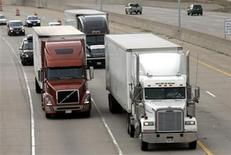 <p>Two freight trucks are driven on the Fisher freeway in Detroit, Michigan March 27, 2009. REUTERS/Rebecca Cook</p>