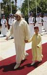 <p>Morocco's King Mohammed VI (L) and his son, Crown Prince Moulay Hassan III review an honour guard during an official ceremony to celebrate the 10th anniversary of his ascension to the throne, in Tangier July 30, 2009. REUTERS/Royal Palace/Handout</p>