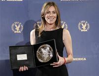 "<p>Director Kathryn Bigelow holds her plaque for her film ""The Hurt Locker"" being a nominee in the 2009 DGA Feature Film Award category at the 62nd Annual Directors Guild of America Awards in Los Angeles January 30, 2010. REUTERS/Danny Moloshok</p>"