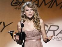 "<p>Singer Taylor Swift speaks onstage with her award for best female country vocal performance for ""White Horse"" during the pre-telecast of the 52nd annual Grammy Awards in Los Angeles January 31, 2010. REUTERS/Danny Moloshok</p>"
