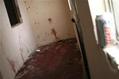 <p>Комната, залитая кровью. Сьюдад Хуарес, Мехико 31 января 2010 года. Хорошо вооруженные люди устроили бойню на дне рождения студента в мексиканском городе Сьюдад Хуарес, убив 14 человек. REUTERS/Alejandro Bringas</p>