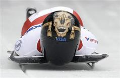 <p>Mellisa Hollingsworth of Canada competes in the women's skeleton race during the Bobsleigh and Skeleton World Cup competition in the Bavarian resort of Schoenau am Koenigssee January 8, 2010. Hollingsworth won ahead of Germany's Kerstin Szymkowiak and Shelley Rudman of Britain. REUTERS/Michaela Rehle</p>