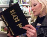 <p>A young Czech woman reads a copy of Hitler's manifesto Mein Kampf in a central Prague bookstore March 27, 2000. REUTERS/Petr David Josek</p>