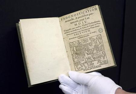 A 16th-century edition of predictions by Nostradamus, the first book to be digitised by Google from a collection of 500,000 at the Municipal Library of Lyon, is displayed by a librarian in this January 15, 2010 file picture. REUTERS/Robert Pratta/Files