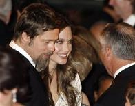 <p>Brad Pitt (L) and Angelina Jolie (C) attend the UNICEF Ball honoring producer Jerry Weintraub in Beverly Hills, California December 10, 2009. REUTERS/Fred Prouser</p>
