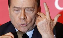 "<p>Italy's Prime Minister Silvio Berlusconi gestures as he attends the presentation of Italian anchorman Bruno Vespa's latest book ""Donne di Cuori"" (women of hearts), in downtown Rome February 10, 2010. REUTERS/Alessandro Bianchi</p>"