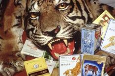 <p>This undated handout image shows Chinese medicines, containing tiger and rhino parts, confiscated by the US Fish and Wildlife Service at Los Angeles International Airport. Demand by a newly rich Asian population for such goods as tiger bone tonic wine and tigers' skin, meat and teeth is putting pressure on these endangered creatures worldwide, wildlife advocates reported on February 10, 2010. REUTERS/Wil Lujiif-WWF-Canon/Handout</p>