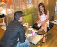 <p>A man and a woman take part in a speed dating event in this undated handout photo. REUTERS/Fastlife.ca/Handout</p>