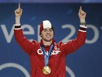 <p>Canada's gold medalist in men's moguls freestyle skiing, Alexandre Bilodeau, poses during the presentation ceremony at the Vancouver 2010 Winter Olympics, February 15, 2010. REUTERS/Chris Helgren</p>