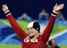 <p>Marianne St-Gelais of Canada celebrates her silver medal during the flower ceremony for the women's 500 metres short track speed skating event during the Vancouver 2010 Winter Olympics, February 17, 2010. REUTERS/Gary Hershorn</p>