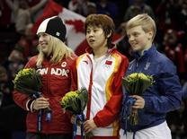 <p>L'azzurra Arianna Fontana, la prima a destra sul podio a Vancouver. REUTERS/David Gray (CANADA)</p>