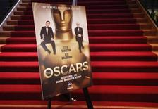 <p>A poster showing Alec Baldwin (L) and Steve Martin as hosts of the 82nd annual Academy Awards is seen at the bottom of the steps to the Samuel Goldwyn Theater in the Academy's headquarters building after the nominations announcements in Beverly Hills February 2, 2010. REUTERS/Danny Moloshok</p>
