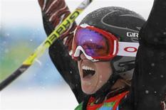 <p>Canada's Ashleigh McIvor celebrates after winning the gold medal in the women's ski cross finals during the Vancouver 2010 Winter Olympics February 23, 2010. REUTERS/Mark Blinch</p>
