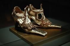 """<p>Slap-sole shoes, probably Italian, mid-17th century, are seen on display in the """"On a Pedestal: From Renaissance Chopines to Baroque Heels"""" exhibition at the Bata Shoe Museum in Toronto, January 7, 2010. REUTERS/Mark Blinch</p>"""
