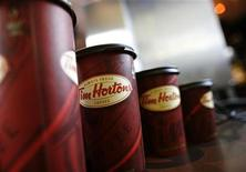 <p>A row of Tim Hortons coffee cups are lined up for customers at Penn Station in New York, July 13, 2009. REUTERS/Brendan McDermid</p>