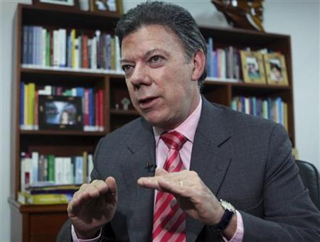 Colombia's former Defence Minister Juan Manuel Santos gestures during an interview with Reuters in Bogota February 10, 2010. REUTERS/John Vizcaino