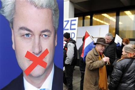 A crowd of protesters gather behind police barriers to voice support for right-wing Dutch MP Geert Wilders outside the court in Amsterdam, where Wilders appeared to be charged with inciting hatred and discrimination against Muslims, January 20, 2010. REUTERS/Toussaint Kluiters/United Photos