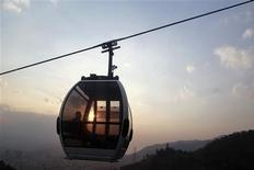 <p>A man rides a cable car to the top of El Avila National Park in Caracas March 11, 2010. Caribbean heat mingles with Andean cool in Caracas, which is nestled against a verdant mountain range, cresting at over 9,000 feet (2,765 meters). REUTERS/Jorge Silva</p>