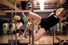 <p>Pole dancing class at Crunch Fitness, New York City, 2009. REUTERS/Crunch/Handout</p>