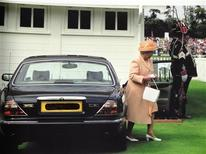 <p>Queen Elizabeth exits her former-Daimler V8 in this undated handout photo. REUTERS/Handout</p>