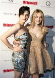"""<p>Cast members Kristen Stewart (L) and Dakota Fanning pose for photographers as they arrive at the premiere of """"The Runaways"""" in New York City March 17, 2010. REUTERS/Jessica Rinaldi</p>"""